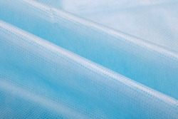 non woven fabric texture background . nylon fabric Macro detail view of texture of blue woven synthetic waterproof clothing. Waterproof fabric