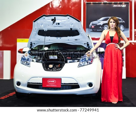 NONTABURI,THAILAND-MAY,15: a Nissan Leaf electric vehicle on display with pretty girl at the Super Car & Import Car Show,May 15,2011 in Nontaburi, Thailand