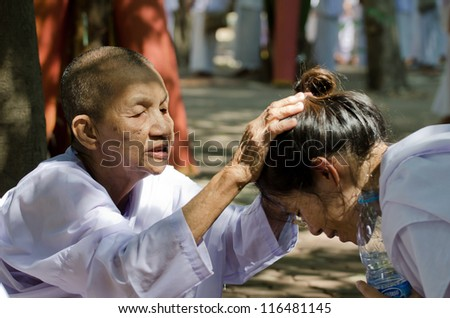 NONTHABURI THAILAND-APRIL 13:people celebrate Songkran (new year / water festival: 13 April) by pouring water for nun and asking for blessings on April 13, 2012 in Nonthaburi,Thailand . - stock photo