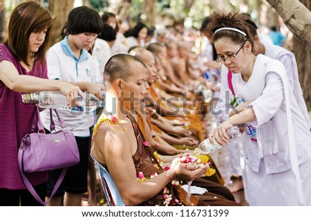 NONTHABURI THAILAND-APRIL 13:people celebrate Songkran (new year / water festival: 13 April) by pouring water for buddhist priest and asking for blessings on April 13, 2012 in Nonthaburi,Thailand.