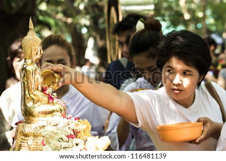 NONTHABURI THAILAND-APRIL 13: people  showering buddha statue in Songkran festival in templed on April 13, 2012 in Nonthaburi,Thailand.