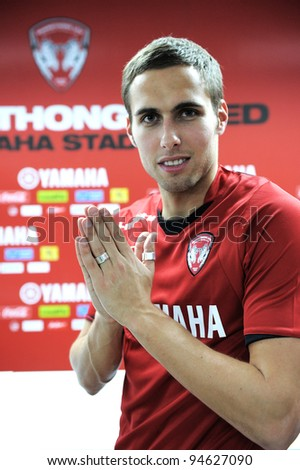"NONTHABURI THAILAND FEB 08:Mario Yurovski, new player of Muangthong United poses a thai way traditional ""wai"" during  a press conference at Yamaha Stadium on FEBRUARY 8, 2012 NONTHABURI THAILAND"