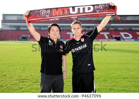 NONTHABURI THAILAND FEB 08:Mario Yurovski (R) with Vice-President Wiluck Lohtong during his press conference as a new player for Muangthong United at Yamaha Stadium on FEB 8, 2012 NONTHABURI THAILAND