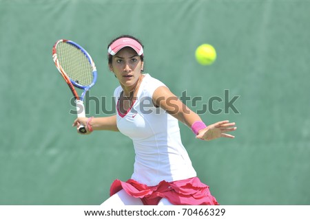 NONTHABURI ,THAILAND - FEB 4 : Oman tennis player  Fatma Ai Nabhani during her Fed Cup, 2011 World Group Play-Off singles match vs. Ling Zhang ,February 4, 2011 in Nonthaburi ,Thailand