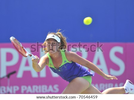 NONTHABURI ,THAILAND - FEB 4 :   Thailand tennis player  Noppawan Lertcheewakam during her Fed Cup, 2011 World Group Play-Off singles match vs. Sania Mirza ,February 4, 2011 in Nonthaburi ,Thailand