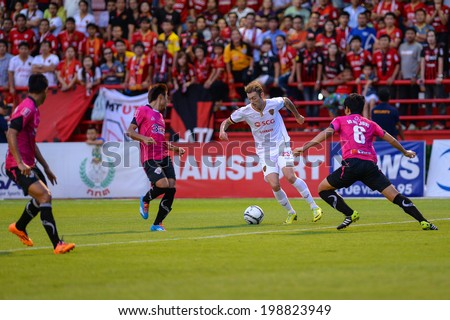 Nonthaburi THAILAND-Jun11:Milan Bubalo(w) of SCG MTUTD in action during Toyota League Cup Big Bang Chula Utd and Muangthong Utd.at Nonthaburi Municipality Stadium on June 11,2014,Thailand