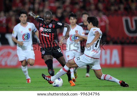 NONTHABURI THAILAND-March17:Christian Kouakou (red) of SCG Muangthong Utd.in action during Thai Premier League between BEC Tero F.C.and SCG MuangThong utd. on March17,2012 in Nonthaburi,Thailand