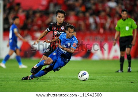 NONTHABURI THAILAND-MAY 27:Adul Lahso (Blue) of Chonburi F.C.in action during Thai Premier League between SCG Muangthong Utd.and Chonburi F.C. on May27,2012 in Nonthaburi,Thailand - stock photo