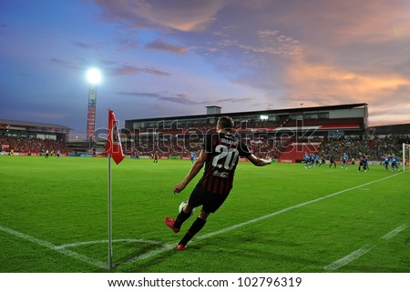 NONTHABURI THAILAND-MAY 17:Mario Gjurovski (no.20) of SCG Muangthong Utd.in action during Thai Premier League between SCG Muangthong Utd.and Army United FC.on May17,2012 in Nonthaburi,Thailand