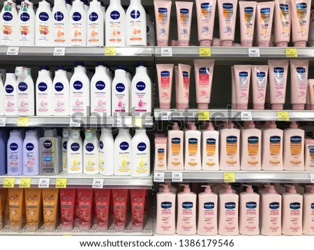 NONTHABURI,THAILAND-1 MAY 2019:Variety of lotion products on shelf for sale on the supermarket.  #1386179546