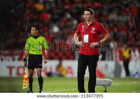 NONTHABURI THAILAND-SEPTEMBER 9:Head Coach Slavisa Jokanovic(red)of SCG Muangthong Utd.in action during Thai Premier League between SCG Muangthong utd.and Wuachon utd. on September 9,2012 in ,Thailand