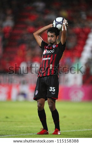 NONTHABURI THAILAND-SEPTEMBER 5:	Weerawut Kayem (red) of SCG Muangthong Utd.in action during Toyota League Cup betaween SCG Muangthong utd.and TOT S.C..at SCG Stadium on Sep 5,2012 in Thailand - stock photo