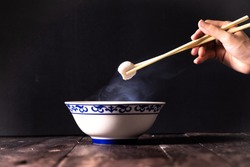 Noodle food Chinese Noodle with fish ball and white bowl on wood table chopstick cooking kitchen