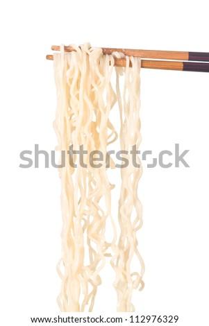 Noodle on chopsticks on white background
