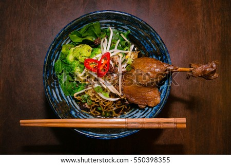 Noodles and chicken in blue bowl #550398355