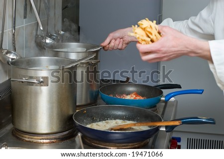 noodles and sauce preparation,  restaurant kitchen