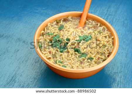 Noodles soup in a bowl on a wooden background - stock photo