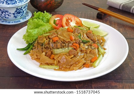 Noodles. Vegetarian food : Stir fried flat noodle with black soy sauce, tofu, carrots and green vegetables. Vegetarian food for vegetarian festival. Thai style stir fry flat noodle. (Pad See Ew)