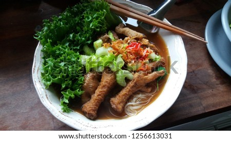 Noodles with chicken legs soup #1256613031