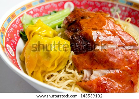 Noodles with roasted duck and dumpling and chinese cabbage.