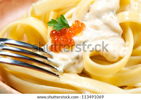noodles with sauce. macro