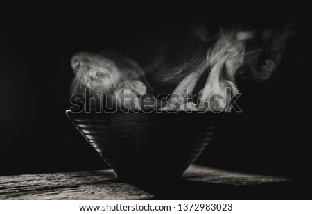 Noodles with steam and smoke in bowl on wooden background, selective focus.selective focus. #1372983023