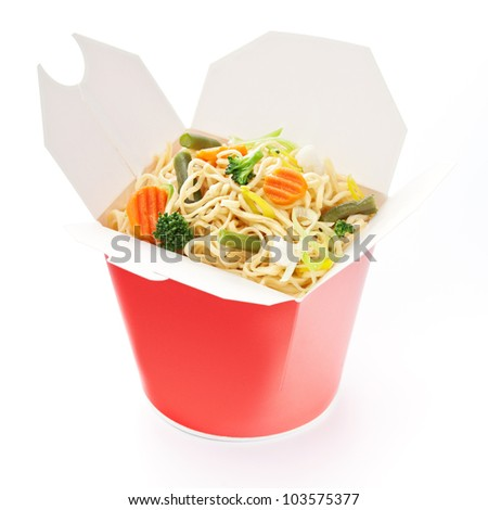 Noodles with vegetables in take-out box on white background