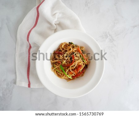 Noodles with vegetables on white plate                          Stok fotoğraf ©