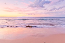 Noosa beach at sunset on the Sunshine Coast in Queensland, Australia