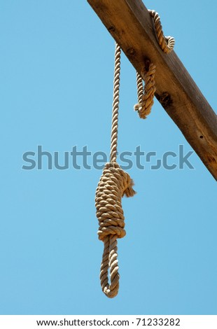 noose hanging from a gallows