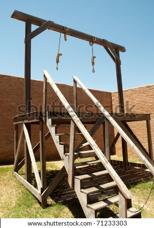 nooses hanging from a gallows