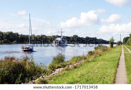 Nord-Ostsee-Kanal with sailboat and mine-hunting boat near Rendsburg, Germany Photo stock ©