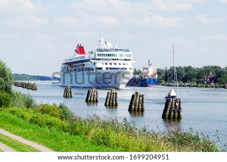 Nord-Ostsee-Kanal with white cruise ship in Oldenbuettel near Rendsburg, Germany Photo stock ©