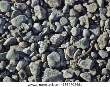 Nordic gray sea pebbles. Background of pebbles. Shot in Sweden.