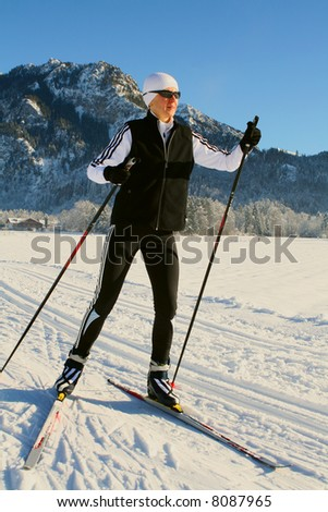 Nordic-skating woman. Near Fuessen in Alps, Germany.