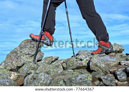 Nordic Walking in Autumn mountains, exercise outdoors