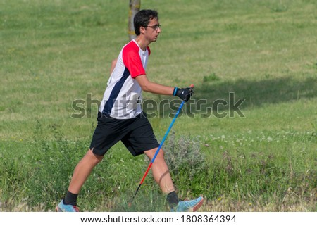 Nordic Walking - Young boy practicing Nordic walking outdoors in the park of Valladolid. Stock photo ©