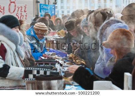 """NORILSK, RUSSIA - NOV 05:  Shopping arcade for the sale of handicrafts peoples of the north at the annual festival of peoples of the Far North """"Bolshoy argish"""" on November 05, 2011 in Norilsk, Russia - stock photo"""