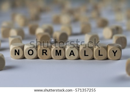normally - cube with letters, sign with wooden cubes Сток-фото ©
