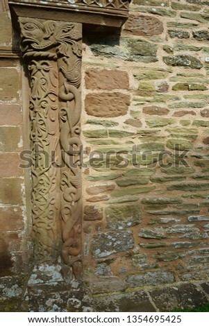 Norman Romanesque sculptures of a Green Man with decorative columns from the South doorway of Church of St Mary and St David, Kilpeck, Herefordshire #1354695425