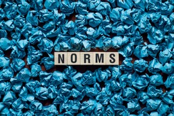 Norms word concept on cubes