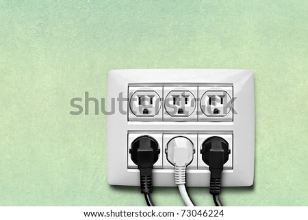 North American electric socket with cables connected on the wall .