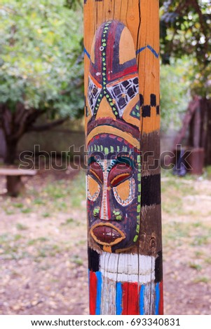 North American totem mask on the totem pole #693340831