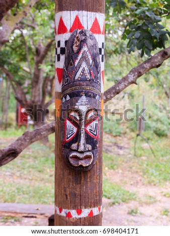 North American totem mask on the totem pole #698404171