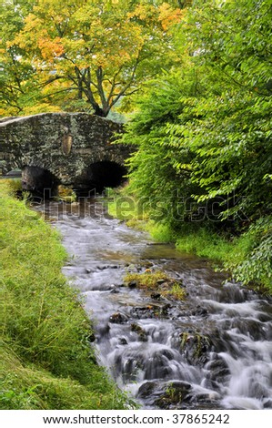 North Carolina Autumn Stone Bridge and Creek Vertical