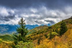 North Carolina Blue Ridge Mountains Blue Ridge Parkway Scenic Autumn Landscape with dramatic sky over fall foliage