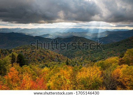 North Carolina Blue Ridge Parkway autumn scenic landscape photography from an overlook of the southern Appalachian Mountains. The mountain landscape features fall foliage on the parkway near Asheville