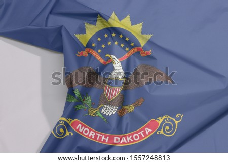 North Dakota fabric flag crepe and crease with white space, the states of America. Flag of the unit by state troops in the Philippine-American War.