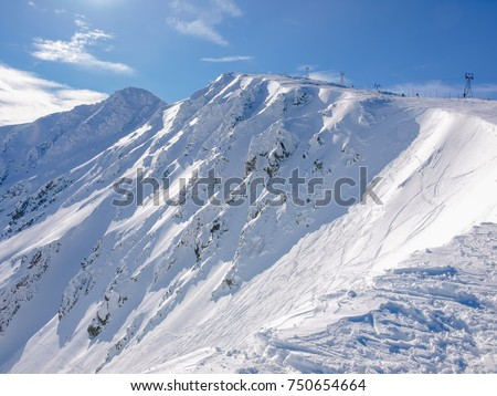 North-east slopes of the mountain Chopok on ski resort Jasna in winter day in Low Tatras mountains, Slovakia #750654664