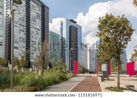 north entrance to La Mexicana city park in Santa Fe, Mexico City with modern buildings beside #1131816971
